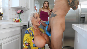 Thirsty granny gets fucked hard in the kitchen