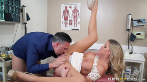 Busty babe fucks her doctor during an examination