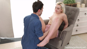Gorgeous teen making love to a shorthaired fella