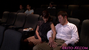 The movie is boring so she gives him a blowjob